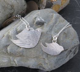 Large and small hand cut doves