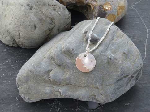 Small round reticulated silver pendant with 'jigsaw' 9ct rose gold design