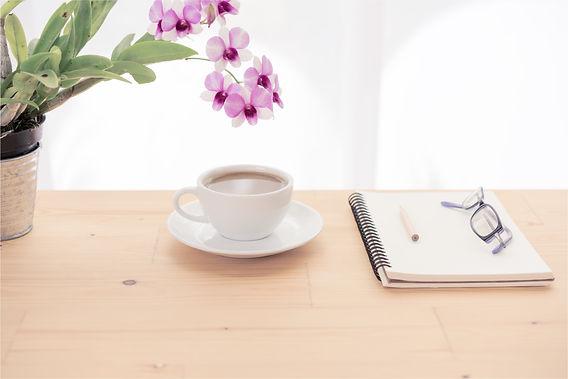 minimal-workspace-coffee-cup-orchid-flow