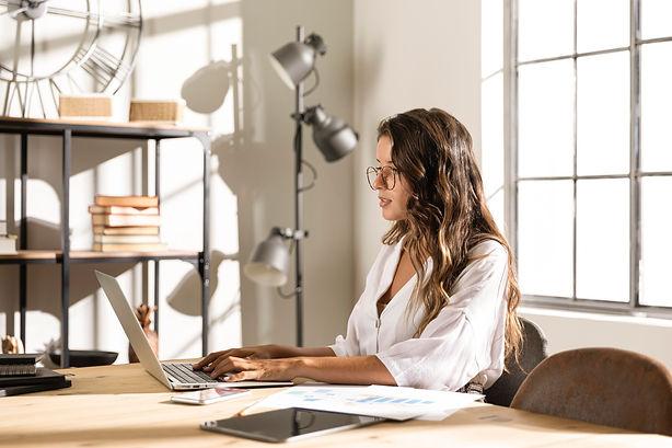 mid-shot-woman-laptop.jpg