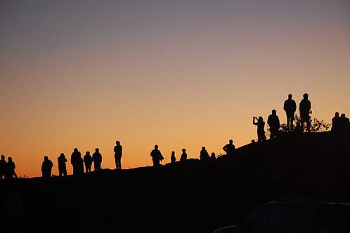 People Silhouetted Watching Sunrise