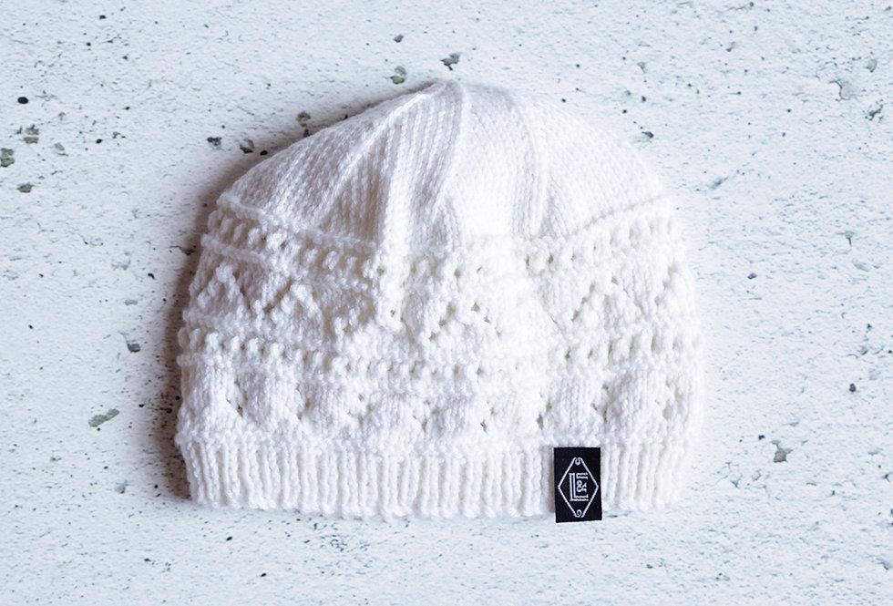Bonnet dentelle tricoté par Lise D.