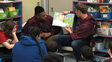 PHILLIPSBURG BASKETBALL VISITS PES FOR READ ACROSS AMERICA