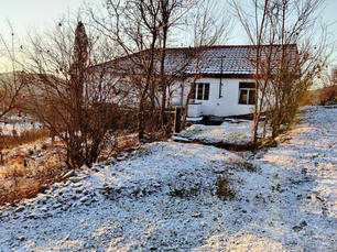Our cottage at sunrise on a winter morning