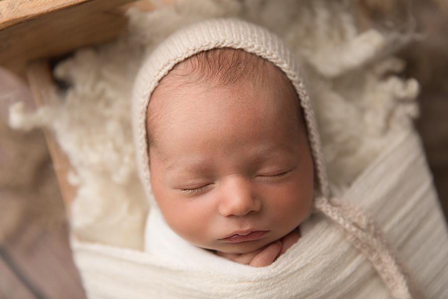 Newborn tucked in bed.jpeg