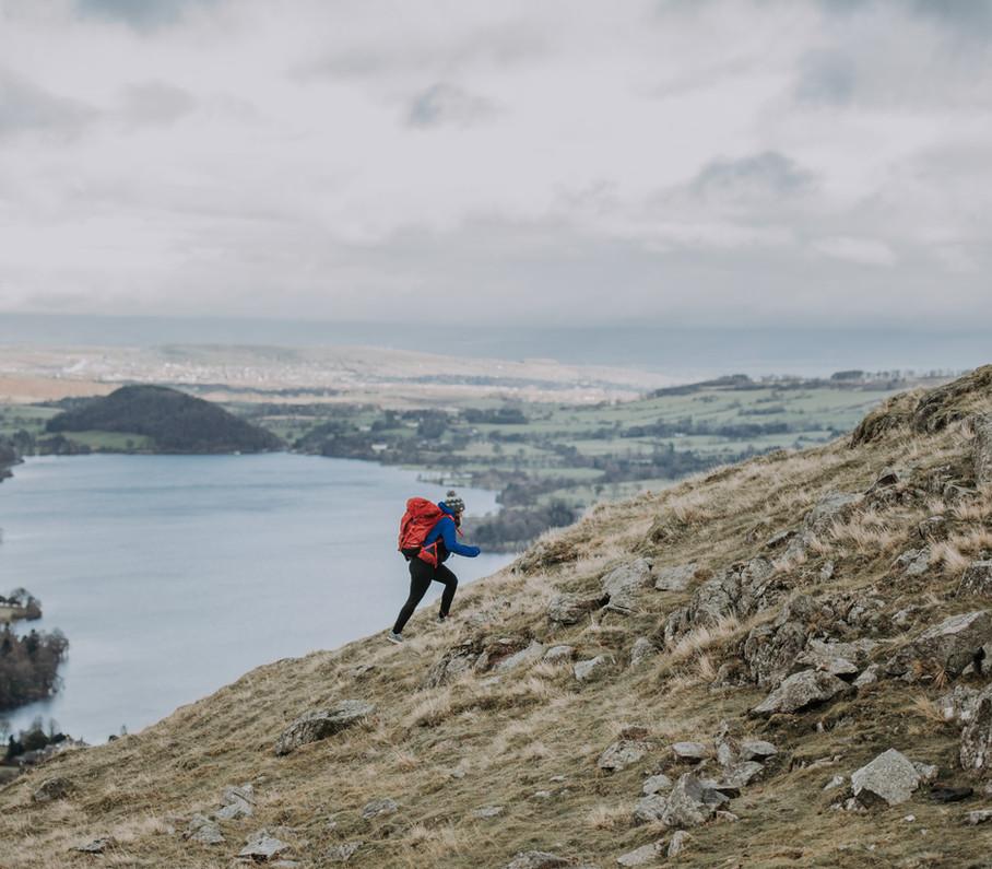Girl walks up mountain Lake District