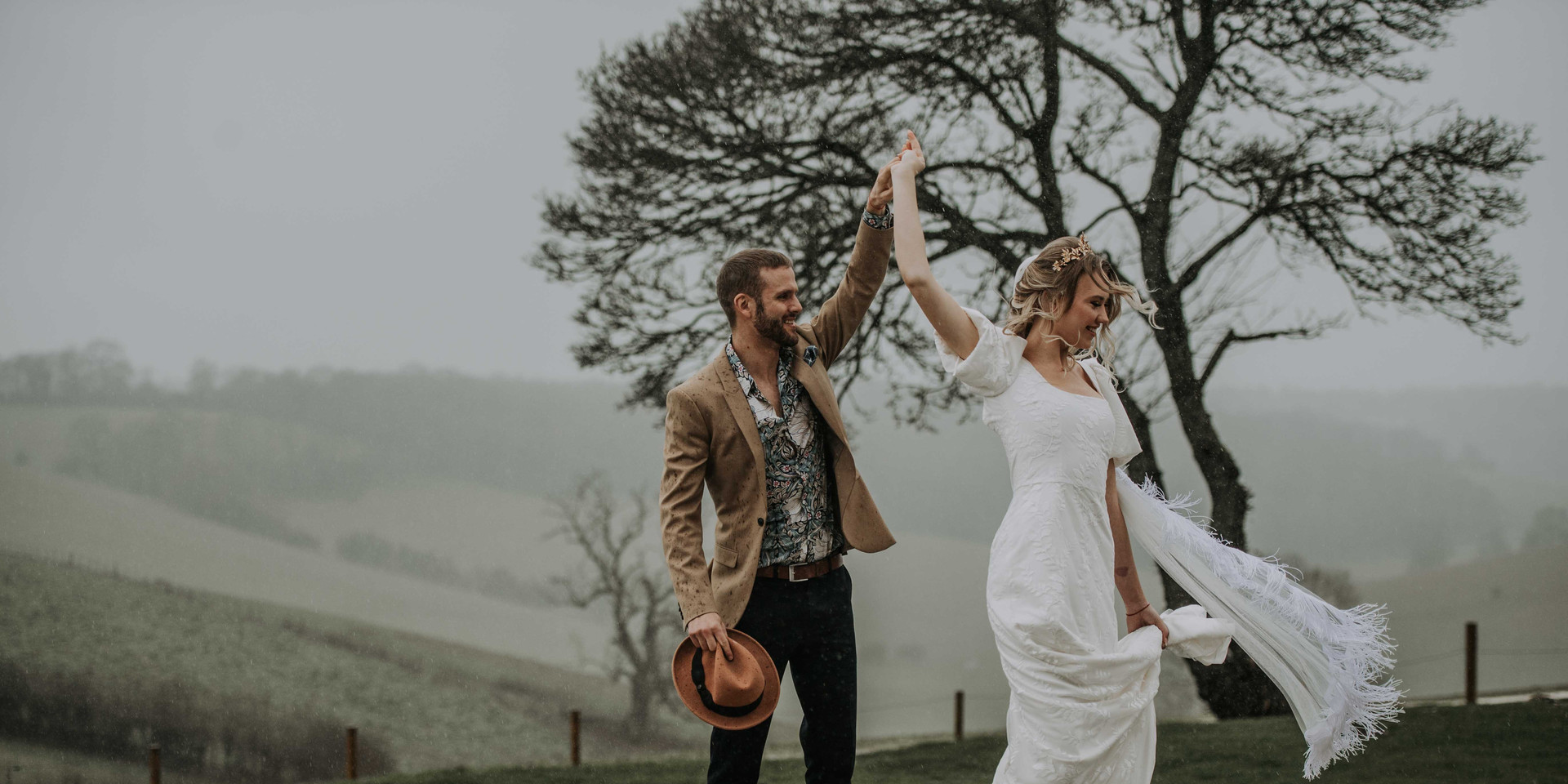 Bride and Groom dancing in the rain at Botley Hill Barn in Surrey