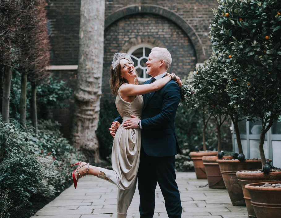 Bride and Groom dancing on wedding day. Bridal jumpsuit