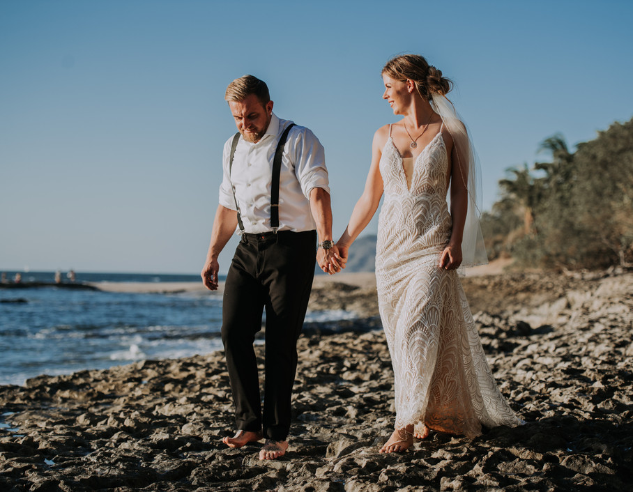 Bride and Groom walking barefoot on the beach at Destination Wedding in Costa Rica