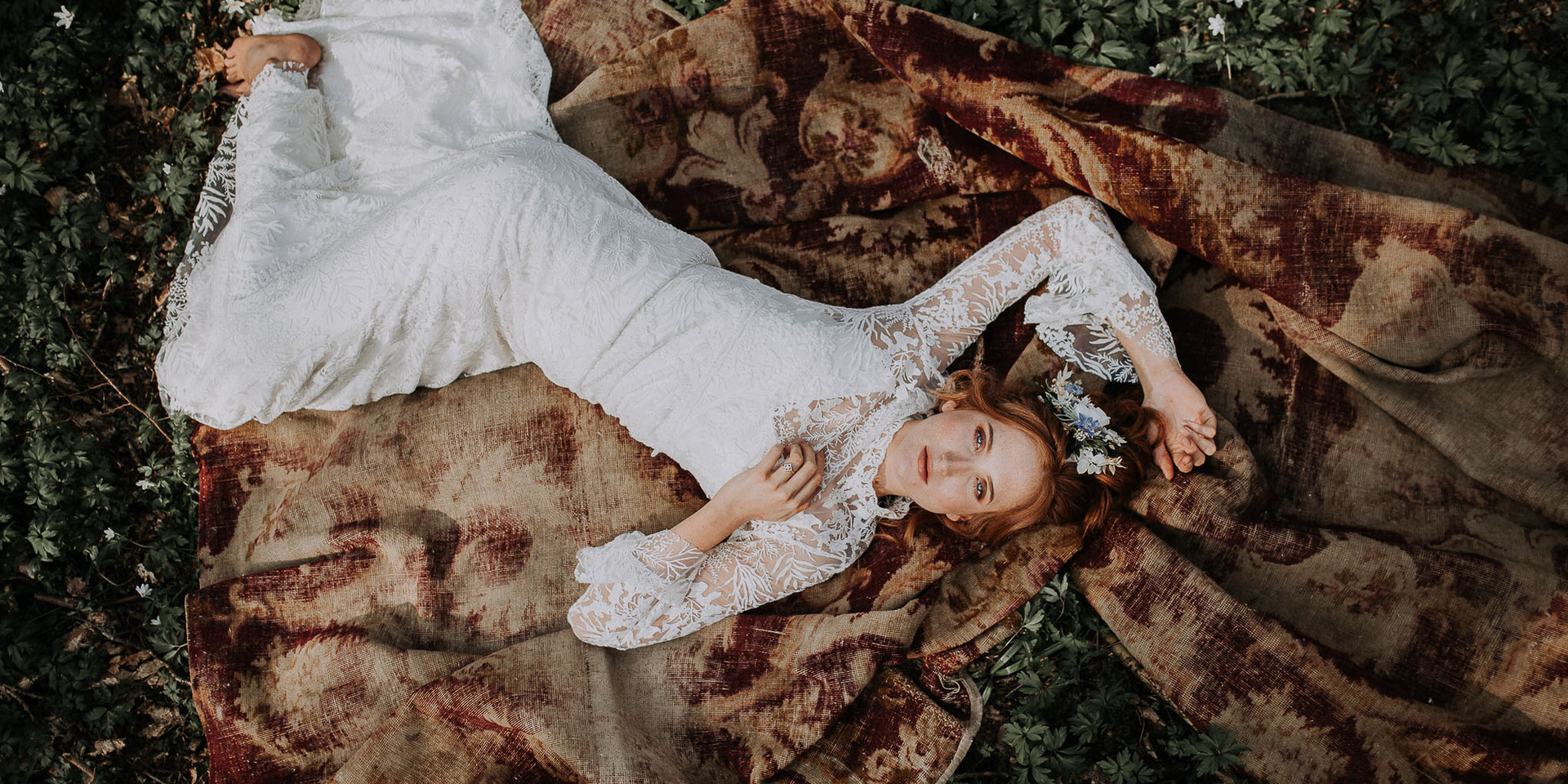 Bride lying in the grass