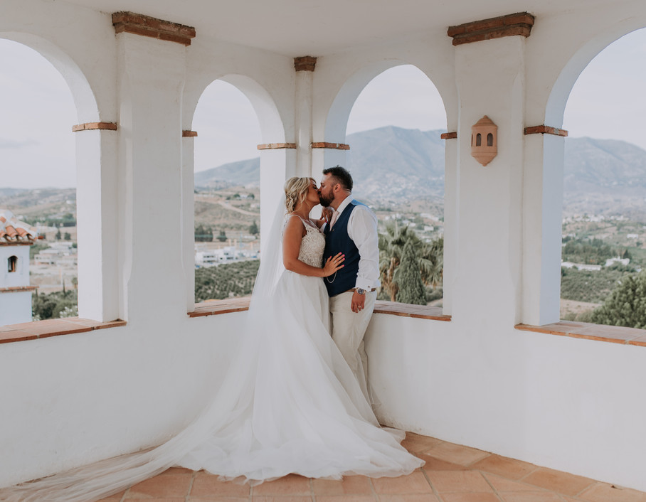 Bride and Groom Kissing in the mountains nn Mijas, Spain