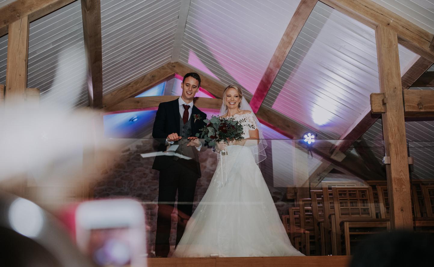 bride and groom at wedding indoors