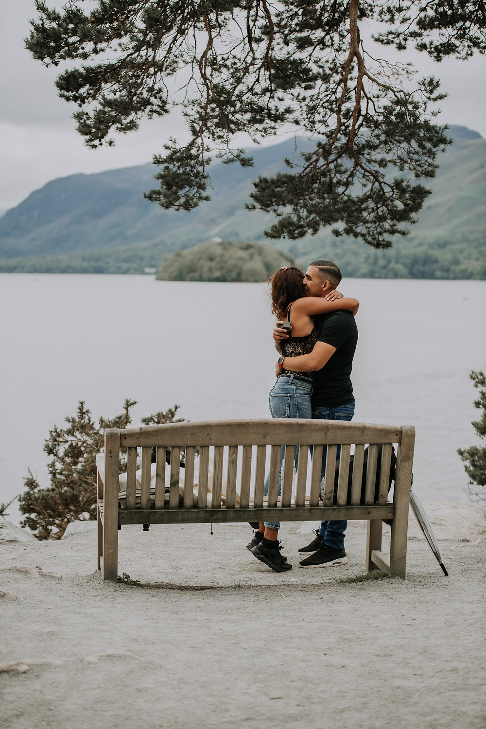 woman hugging man after proposal