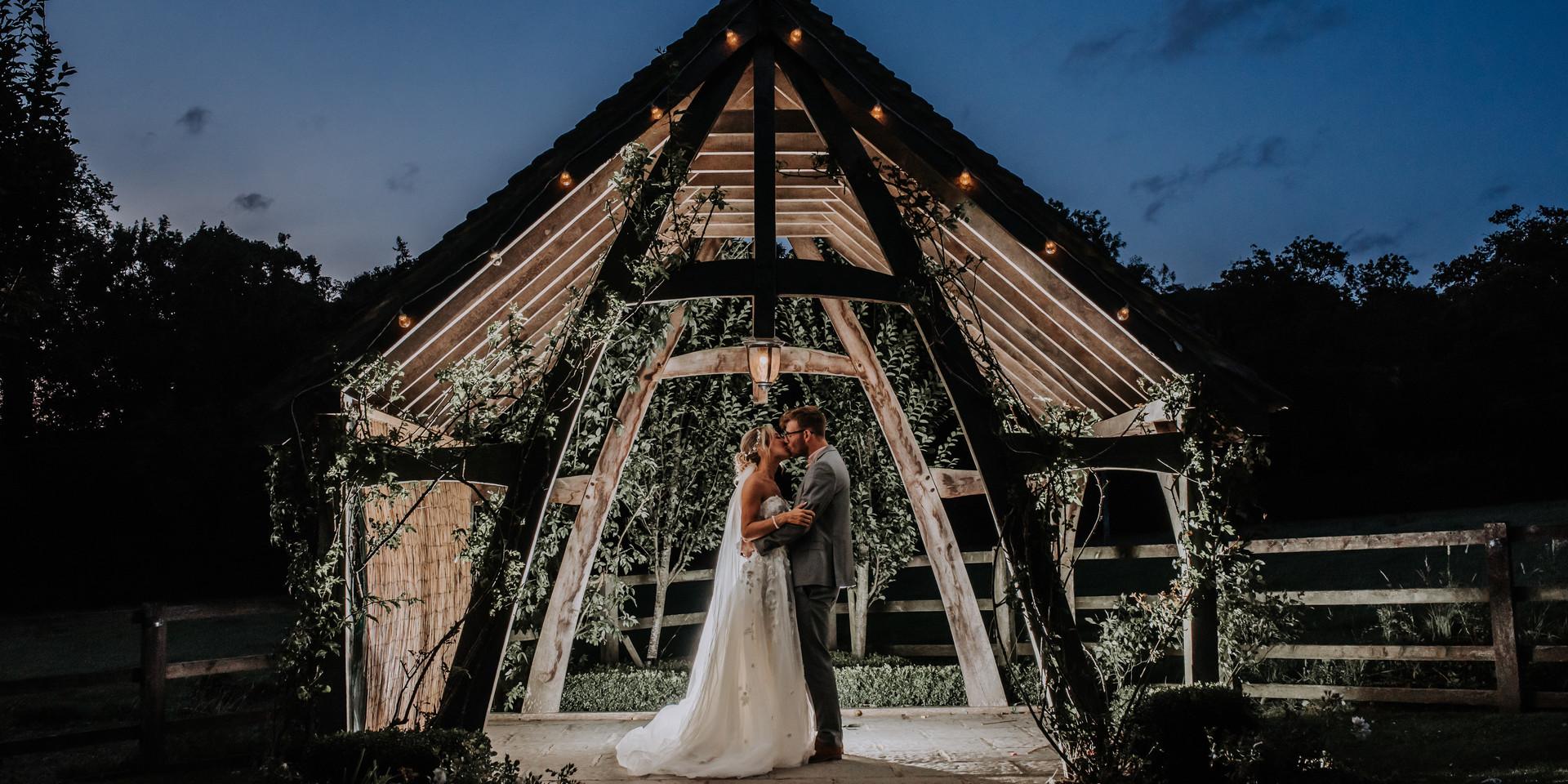 Bride and Groom kissing under moonlight