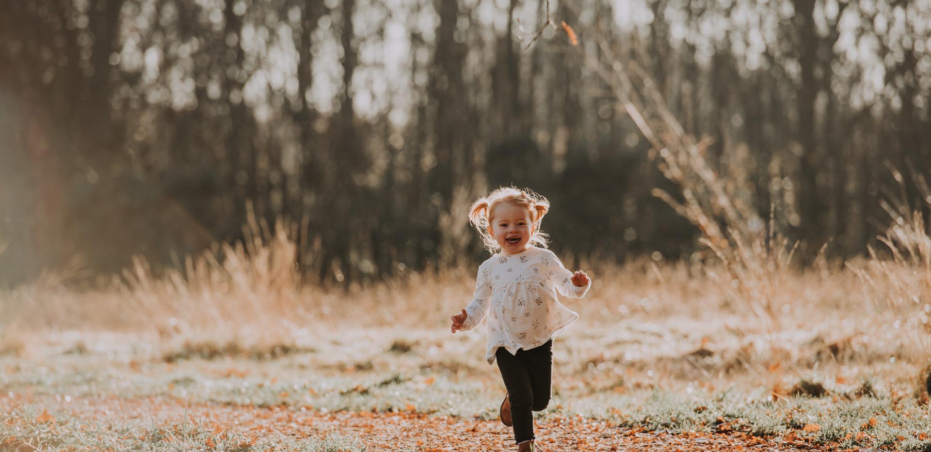 Girl running on family photo shoot