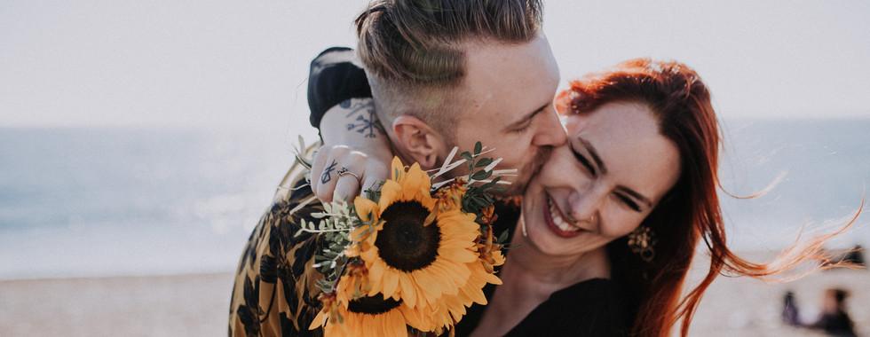 Alternative Bride and Groom on Brighton beach with sunflower Bouquet