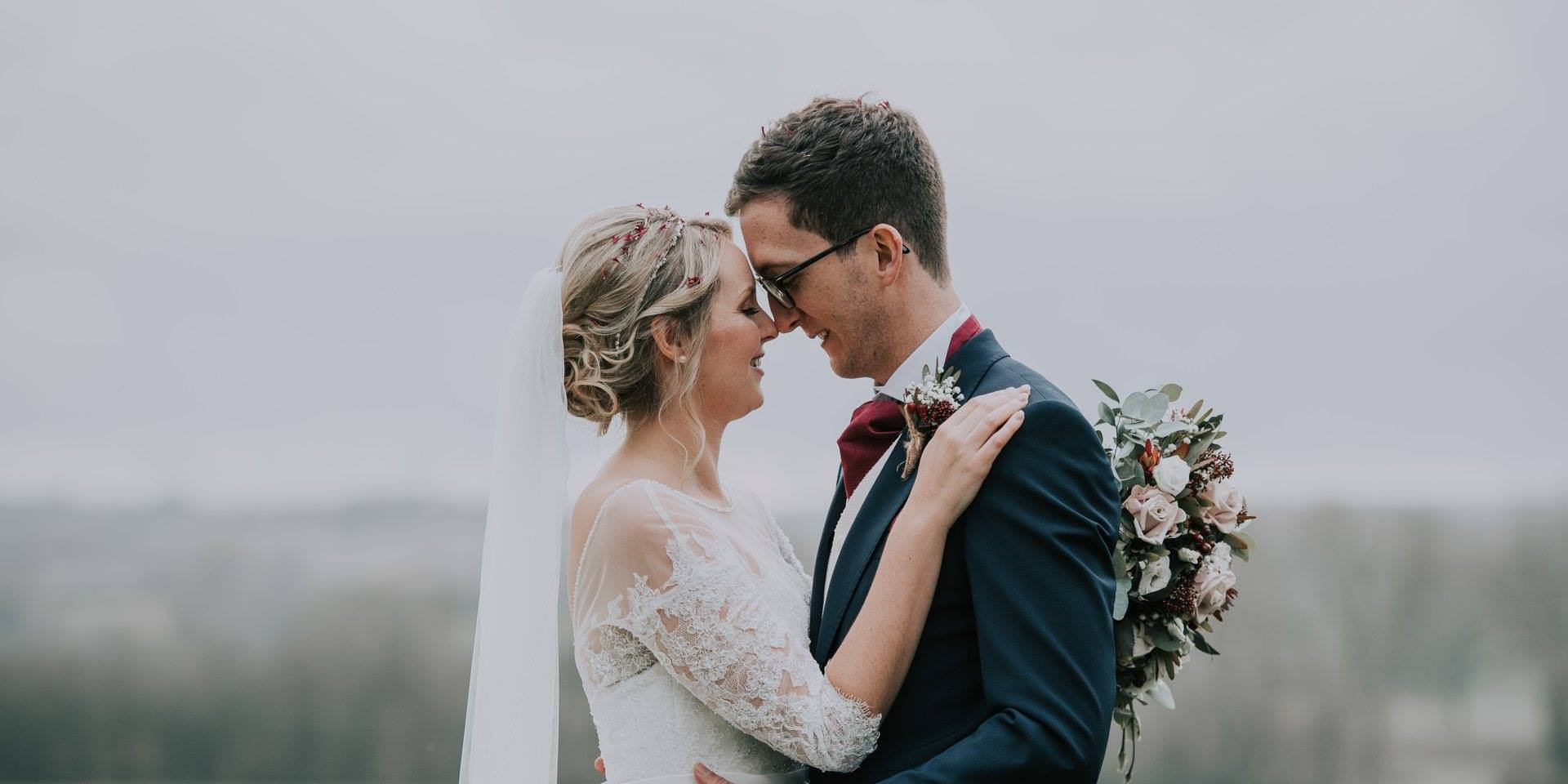 Bride and Groom at winter Wedding on a Farm