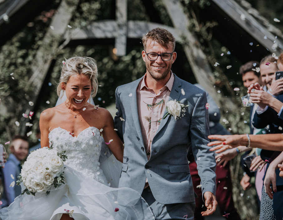Confetti photo of bride and groom in the wind