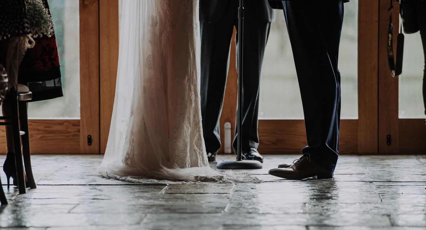 bride and groom wedding feet