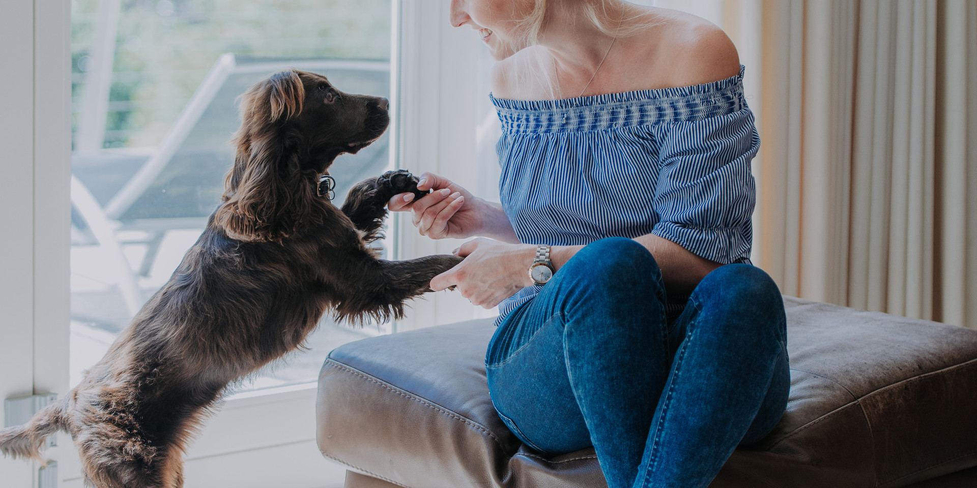 Girls holds her dogs paws