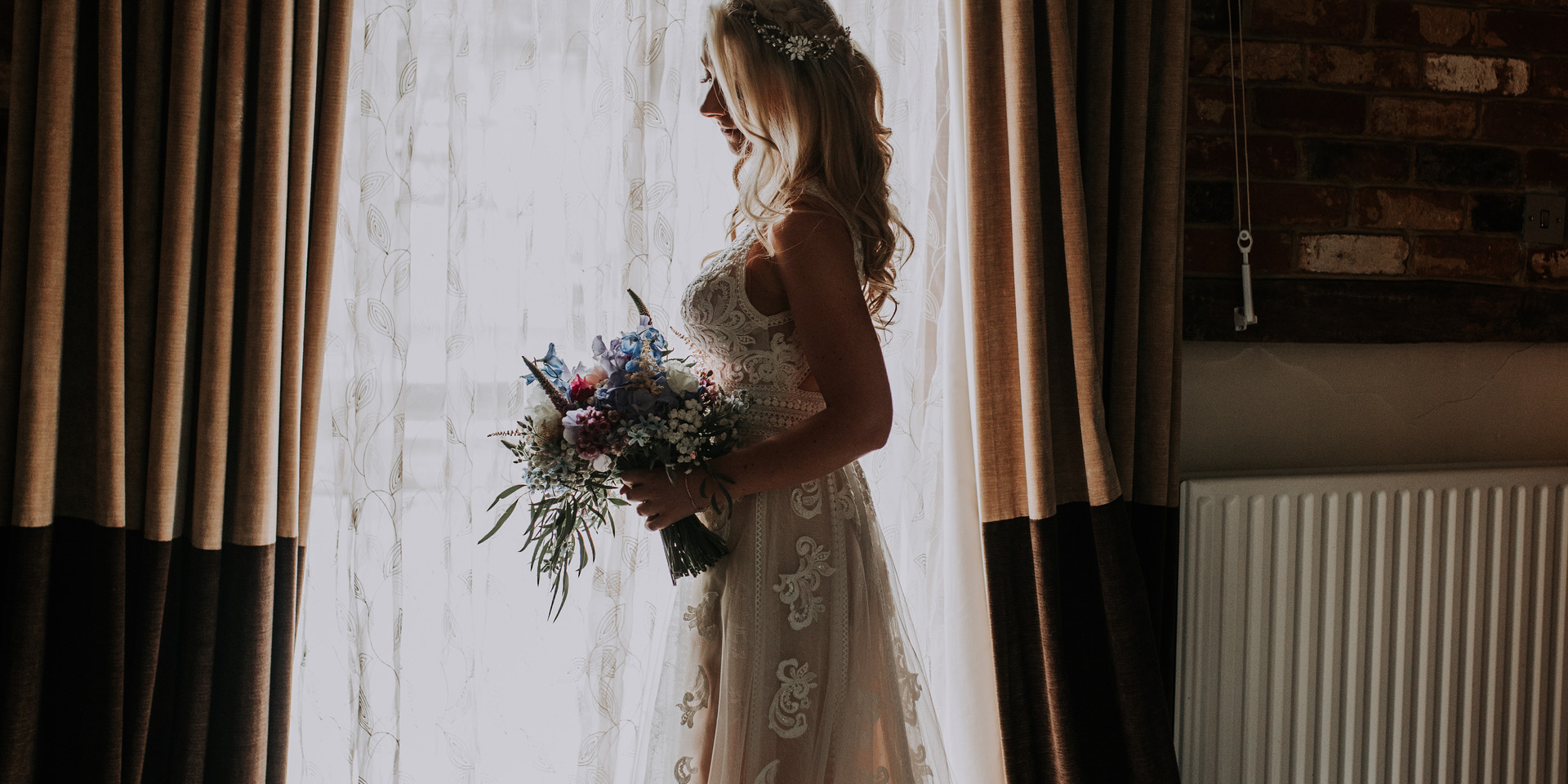 Bride at the windo at Riverdale Barn