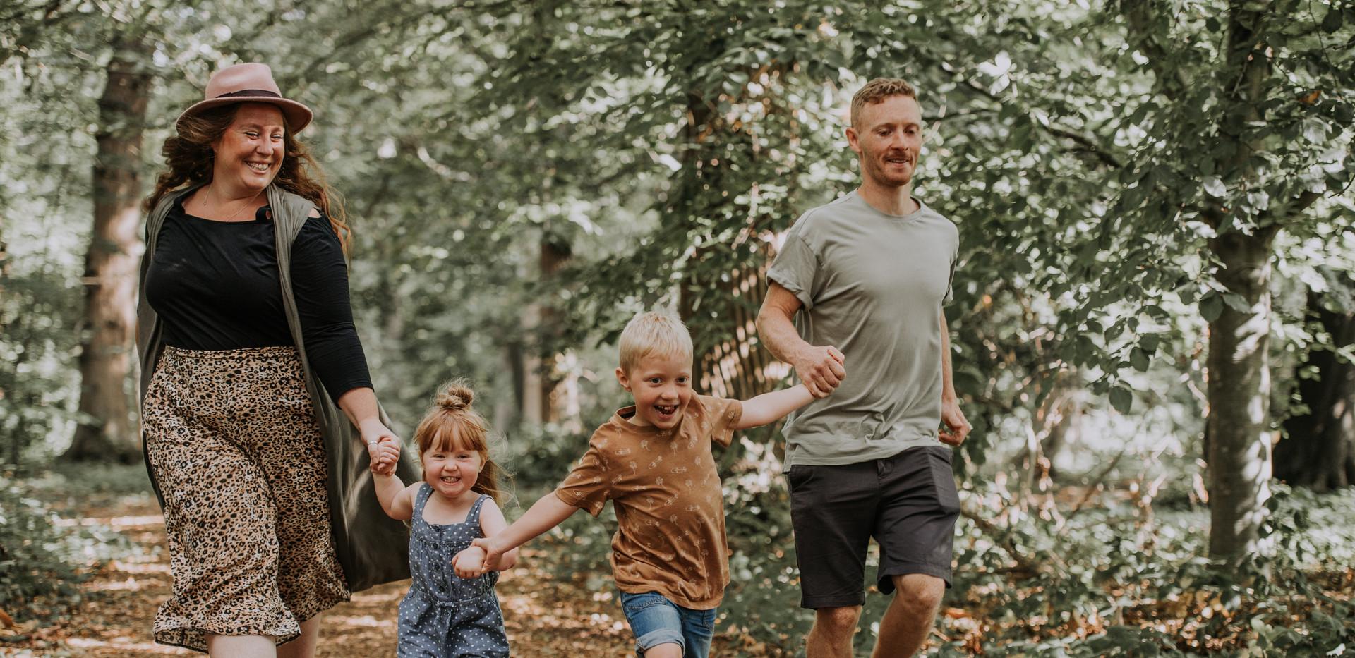 Family running through forest