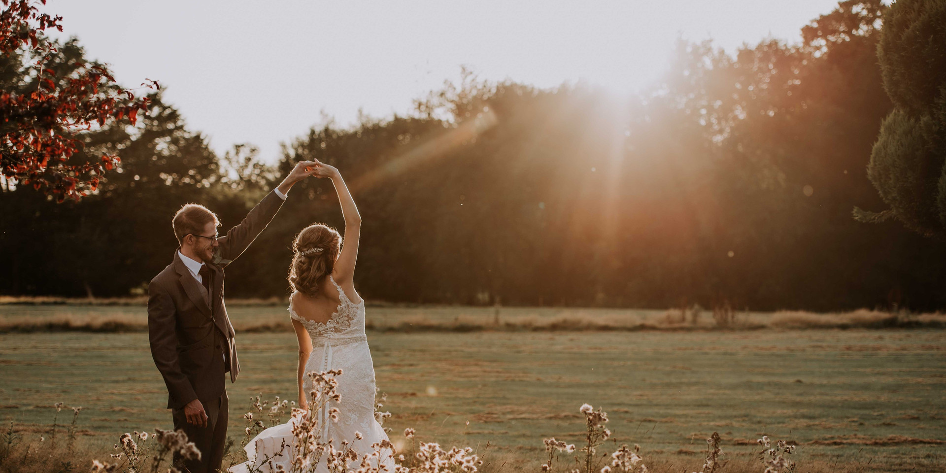 Bride and Groom Dancing at sunset in Brookfield Barn
