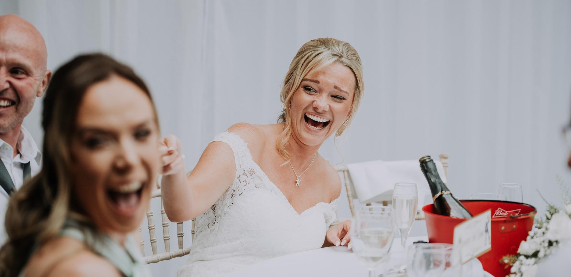 bride laughing at wedding in surrey