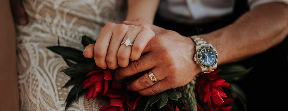 Bride and Groom holding hands. Wedding Rings