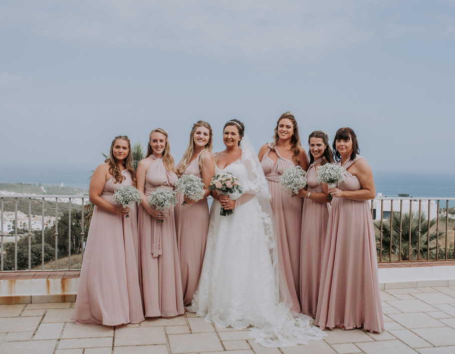 Bride and Bridesmaids at destination wedding in spain. Pink bridemaids