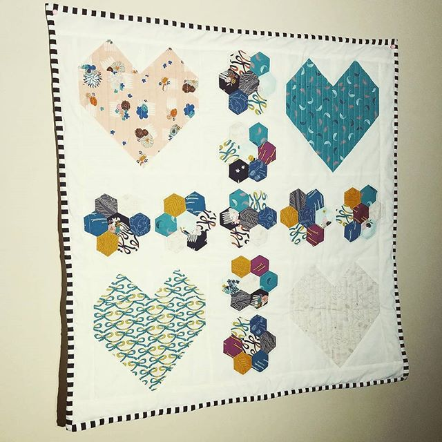 New mini in the shop! #HeartsAndFlowers #MiniQuilt #Hexies #GoodHairDay #StripedBinding