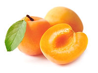 Sweet apricots with leafs isolated on wh