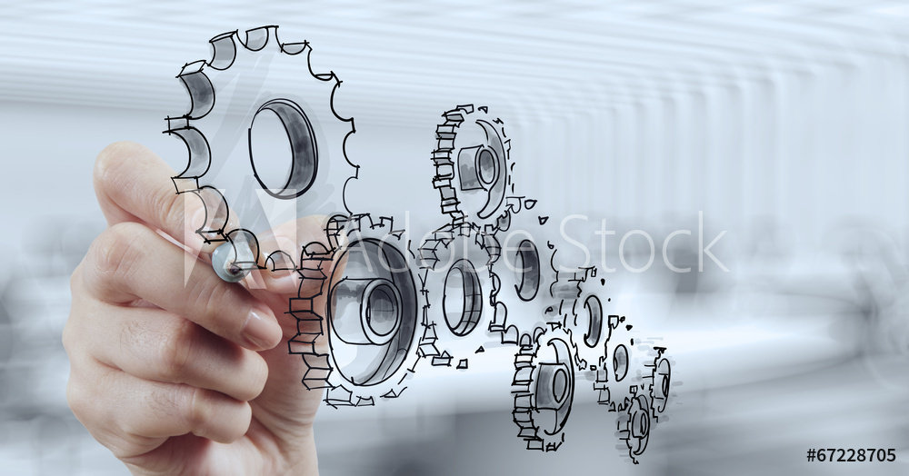 woman's hand drawing gears in air fr Ado