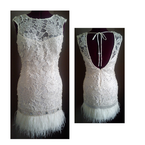 white wedding dress with lace and feather detailing