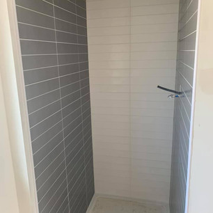 Grey and white tiling in shower unit