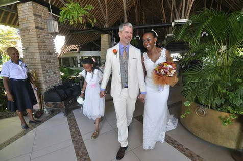 Happy bride and groom with flower girl