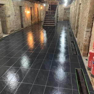 Shiny black tiling in commercial site