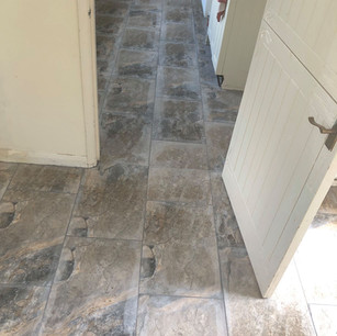 Traditional stone floor in domestic kitchen