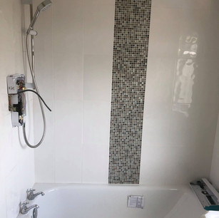 Black and white tiling in domestic bathroom