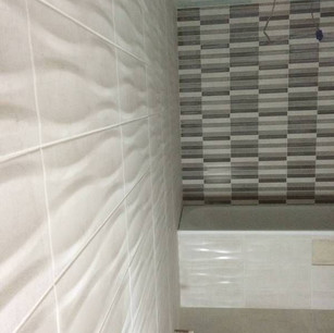 Black, white and grey tiles in bathroom