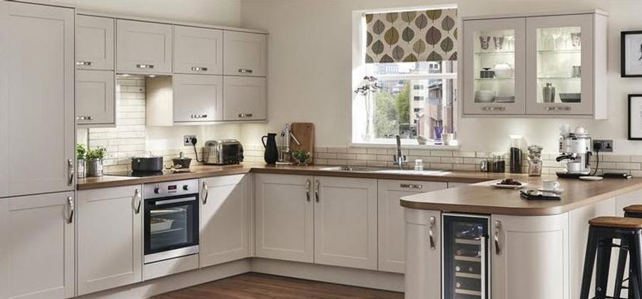 White kitchen with dark wood worktops