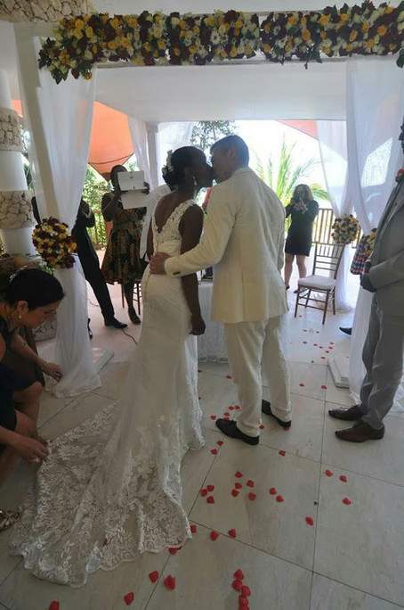 back of bride and groom kissing