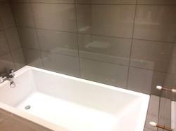 Modern bathroom tiling in grey colour