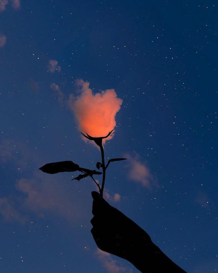 Uma mão segurando o caule de uma flor, formando a planta com uma nuvem