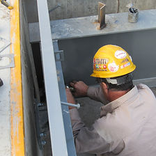 Cech employee performing industrial scale calibration