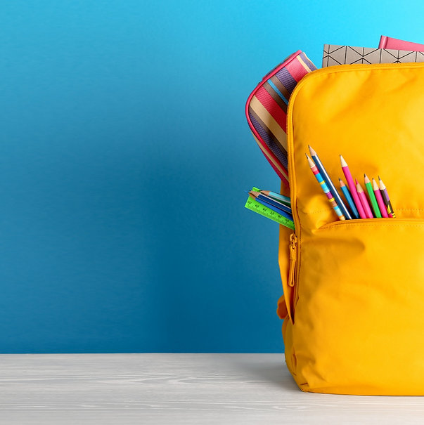 Backpack with different colorful stationery on table_edited.jpg
