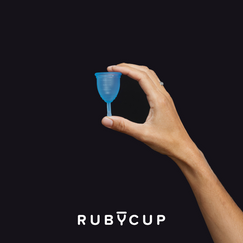 hand shot - blue Ruby Cup - black background.png