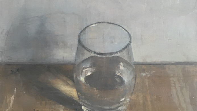 A completely full glass of water and air