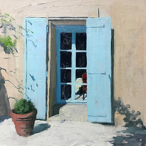 Door way in Provence with a pot