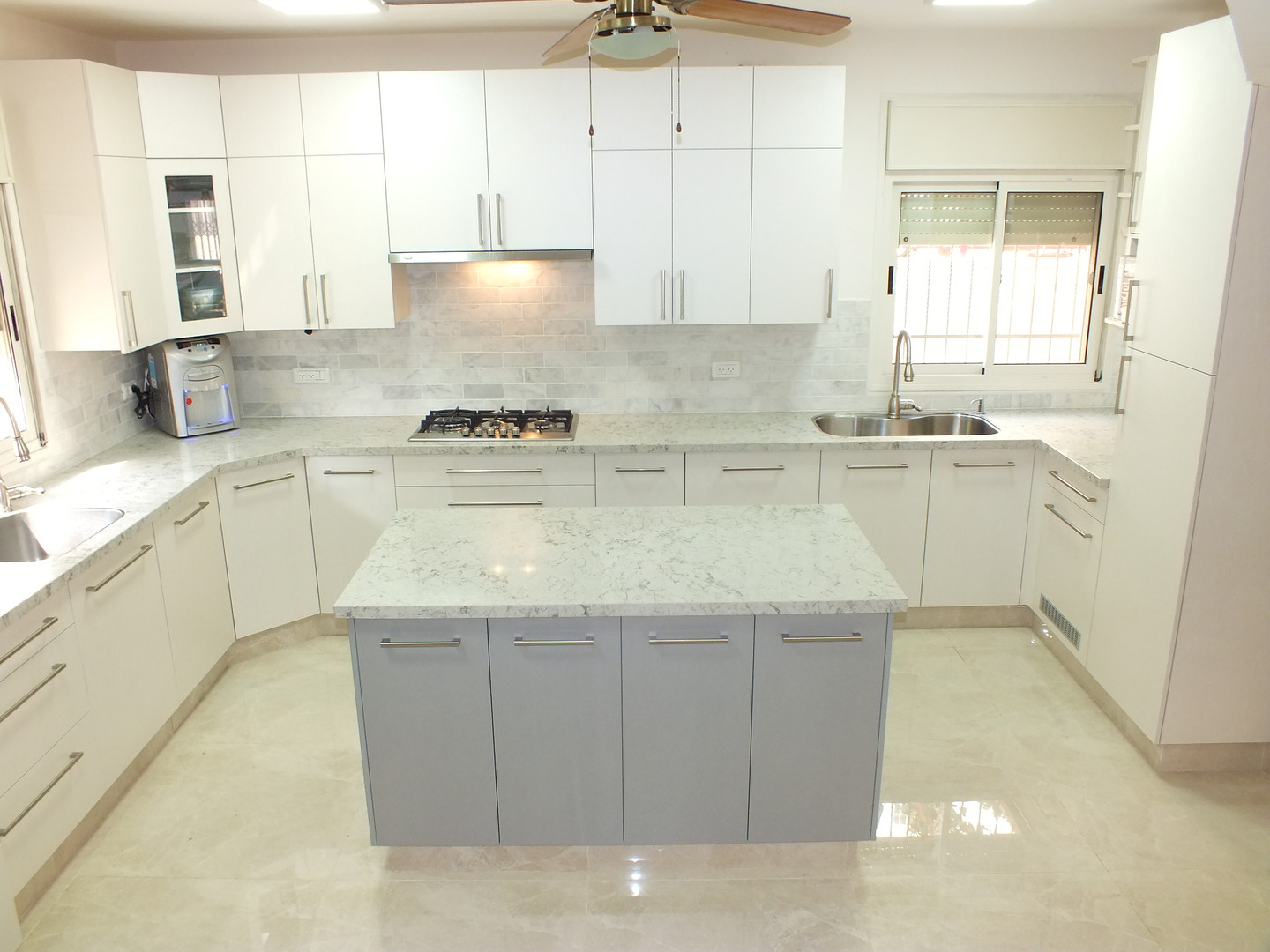 Rounded white with Island Kitchen
